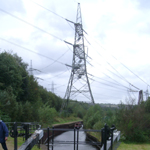 UK: Huddersfield Narrow Canal, passing under a pylon near Staleybridge [Picture by Howard Fisher]